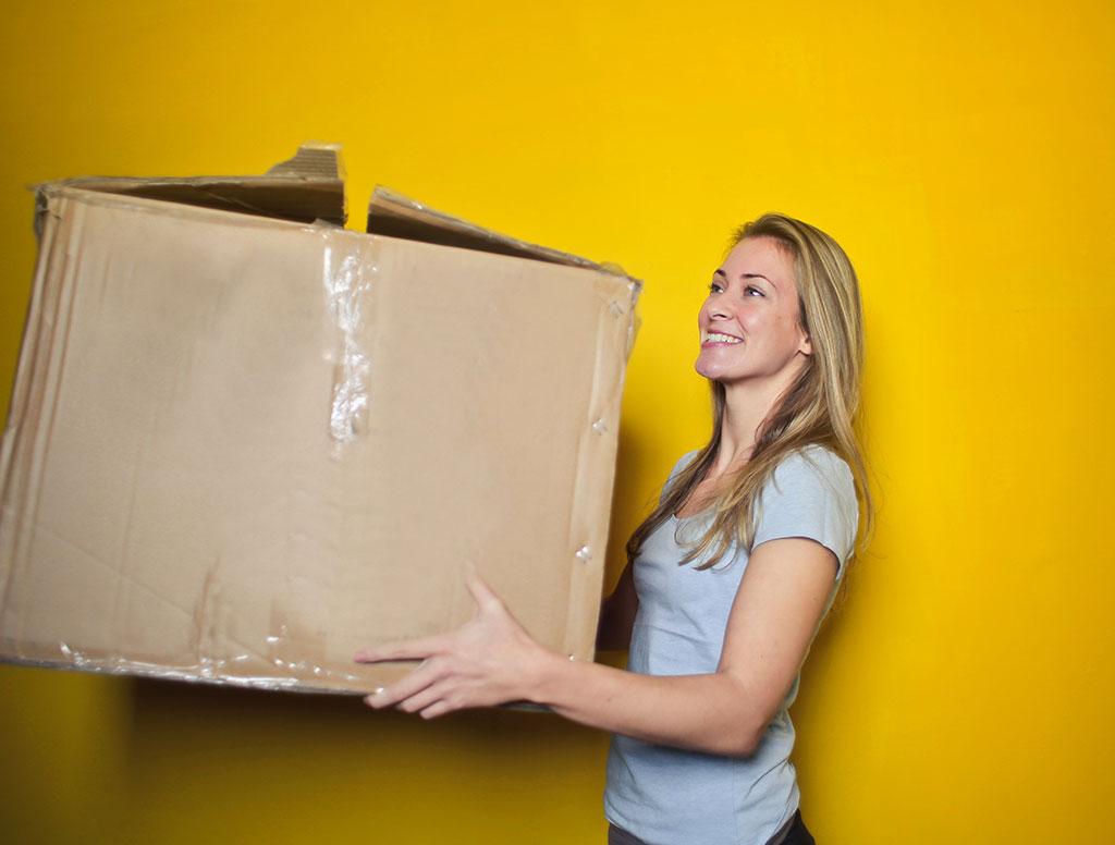 woman lifting box